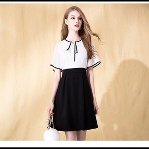 Women's white top and black low bottom dress